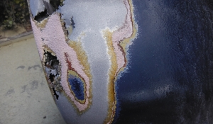 Wet blasting fiber glass, body filler, primers and paint from a car