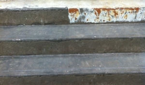 Paint removal from concrete steps prepairing for proper industrial non slip coating